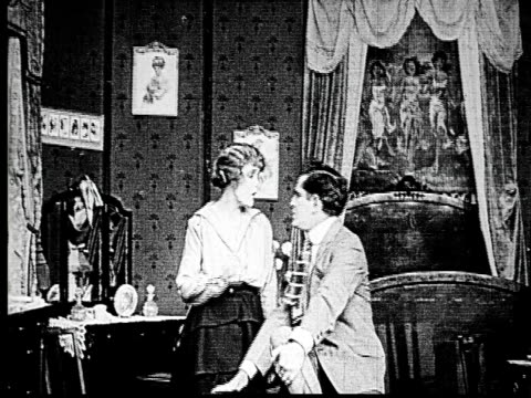 1914 B/W Medium shot Woman and businessman arguing in bedroom