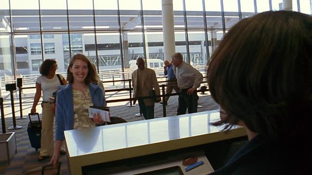 Medium shot woman checking in at airport