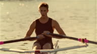 Medium shot young man rowing scull