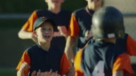 Medium slow motion panning shot of baseball team celebrating / American Fork, Utah, United States