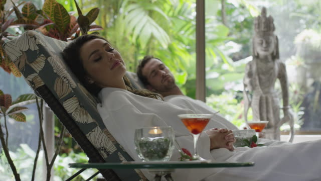 Medium slow motion panning shot of couple relaxing in spa / Arenal, La Fortuna, Costa Rica