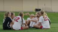 Medium slow motion shot of soccer opponents high-fiving together / Springville, Utah, United States