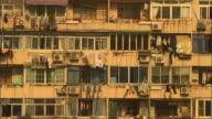 Medium static - Laundry hangs from apartment balcony railings in Shanghai. / Shanghai, China