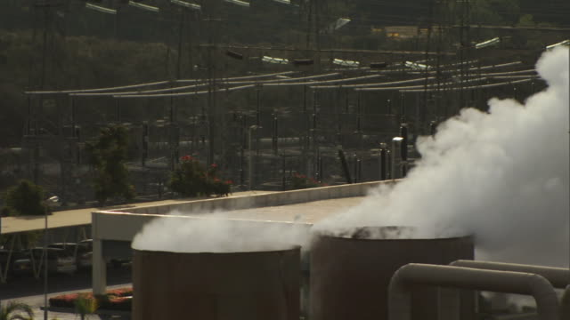 Medium static - Steam rises from cooling towers at the Olkaria Geothermal Power Plant in Olkaria, Kenya. / Olkaria, Kenya