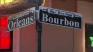 Medium static - Street signs direct travelers to Bourbon and Orleans streets in New Orleans. / New Orleans, Louisiana, USA