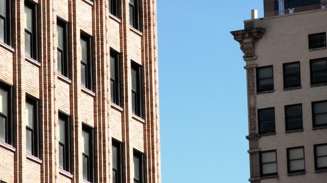 Medium tight shot of two brick buildings.