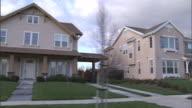 Medium tracking,right , Upper,class homes line a neighborhood street. / California