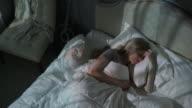 Medium zooming time lapse shot of woman sleeping in bed / Cedar Hills, Utah, United States