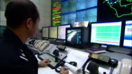 Medium zoom-out - A controller works in a traffic control center./Beijing, China