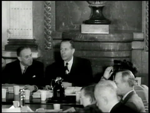 Meeting VS Paul Hoffman sitting w/ William C Foster EXT WS Hoffman and US Diplomat Averell Harriman walking from car INT VS French Foreign Minister...