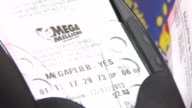 WGN Mega Millions Lottery Tickets Being Printed on December 17 2013 in Chicago Illinois