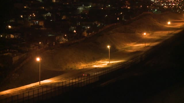US Meixco border at night at US border fence on April 22 2012 in San Diego South California