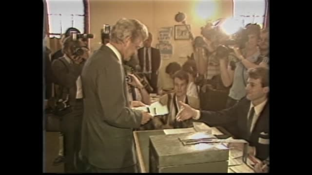 Prime Minister Bob Hawke and wife Hazel arrive at school to vote / cutaway news cameraman / Hawke fills out voting form and into ballot box / Hawke...