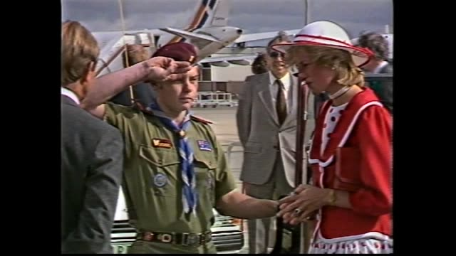 Melbourne RAAF plane taxies / crowd at airport / Prince Charles and Princess Diana down plane steps / meet and greet / Diana at car – boy scout...