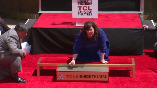 Melissa McCarthy Immortalized With Hand And Footprint Ceremony at TCL Chinese 6 Theatres on July 02 2014 in Hollywood California