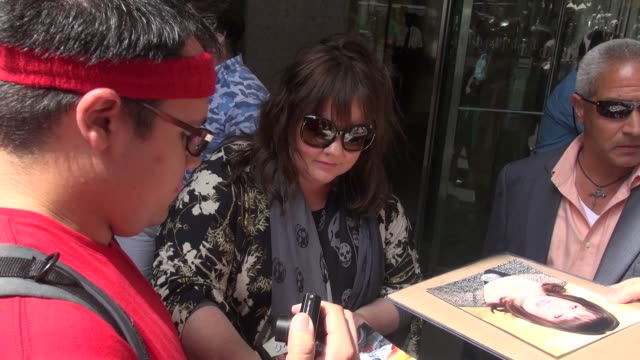 Melissa McCarthy signs for poses with fans outside SiriusXM Satellite Radio in Celebrity Sightings in New York