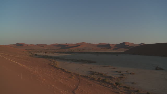 Mellow light glows on the Dunes of Sossusvlei, Namibia.