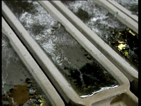 Melted aluminum in small caskets liquid aluminum flowing into caskets via heated wheel