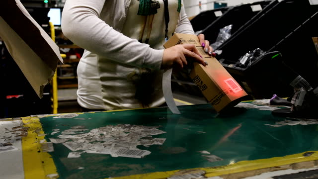 A member of staff packs items for delivery in the Amazon Fulfilment centre on November 15 2017 in Peterborough England A report in the US has...
