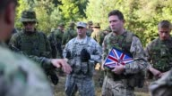 A member of the British Army gives instructions during a road side ambush and IED training exercise that is part of NATO exercises in Yavoriv Ukraine
