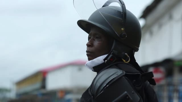 CU A member of the Emergency Response Unit of the Liberian National Police stands guard at the entrance to West Point To contain the spread of Ebola...