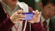 A member of the media tries out a SoftBank Corp Aquos Phone Xx 206SH smartphone manufactured by Sharp Corp during a product launch in Tokyo A member...
