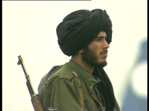A member of the Taliban stands guard at Kabul airport
