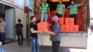 Members of Australian Sadaqa Welfare Fund distribute food aid packages to Syrian refugees on the first day of the Muslim holy fasting month of...