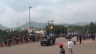 Members of Cameroon's football team do a deep bow to President Biya and delight fans on a victory parade after winning the Africa Cup of Nations