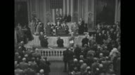 Members of Congress standing and applauding after Winston Churchill's speech / Churchill shakes hands with Speaker of House Sam Rayburn and Vice...