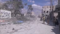 Members of Free Syrian Army patrol in the Syrian town of Al Bab after the town center has been entirely freed from Daesh terrorists as part of the...