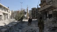 Members of Free Syrian Army seen in Syria's AlBab after taking control of the district's centrum from Daesh terrorists during the 'Operation...