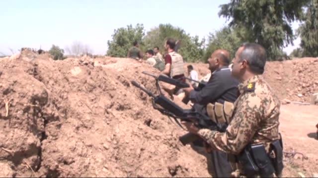 Members of Iraqi Kurdish Peshmerga forces clash with Daesh militants in Meryembeg area of southern Kirkuk Iraq on July 06 2015