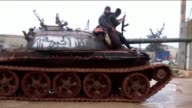 Members of Jabha Shamiyeh a coalition of Syrian opposition groups launch an operation with heavy weapons against a building of Assad Regime Forces in...