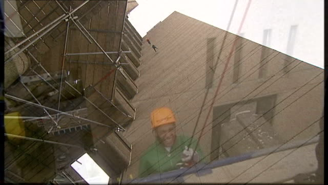 Members of JLS interviewed SOT Various shots of members of JLS abseiling from roof of Trellick Tower block of flats Aston Merrygold interviewed after...