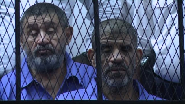 Members of Libyan leader Moamer Kadhafis ousted regime including exintelligence chief Abdullah Senussi appeared in court in Tripoli for a pretrial...