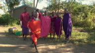 WS Members of Masai tribe dancing and jumping / Serengeti, Tanzania