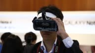 Members of media try out Samsung Electronics Co Galaxy VR Gear at a launch event in Seoul South Korea