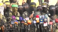 Members of Palestinian armed groups hold a press conference in support of Israeliheld Palestinian prisoners who are on hunger strike to protest their...