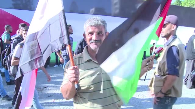 Members of Palestinian Islamist movement Hamas based in Gaza watched on television as their delegation and Fatah signed an agreement Thursday on...