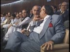 Members of Parliament chat inside the National Assembly of Pakistan
