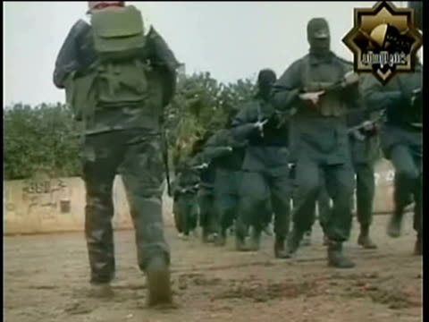 Members of radical Islamist group Fatah alIslam based in northern Lebanon marching and training with rifles/ Lebanon