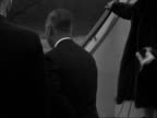 Members of Royal family arrive at London Airport / Kents open Kenya TV Centre in Nairobi London Airport Queen Elizabeth II with corgis down steps of...