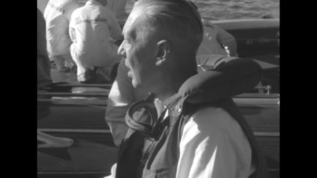 Members of Slomoshun IV congregate on dock at Lake Washington after Stanley Sayres' hydrofoil run