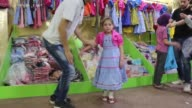 Members of Syrian Adaleh Foundation distribute clothes to children at a sewing workshop ahead of Eid alFitr the threeday celebration marking the end...