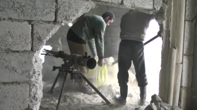 Members of the 16th division of Free Syrian Army launch attacks against the building used as military headquarters by Assad Regime Forces as part of...