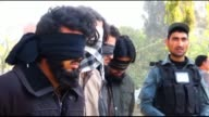 Members of the Afghan security services escort two of four alleged members of the DAESH arrested after clashes with Afghan security forces in the...