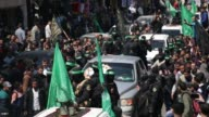 Members of the Ezzedine alQassam Brigades the military wing of the Palestinian Islamist movement Hamas carry the body of Hamas official Mazen Faqha...