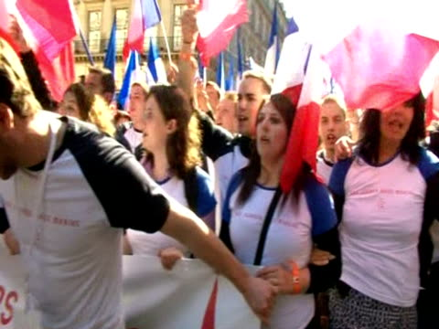 Members of the french political rightwing party Front National march on May Day with tricolour flags