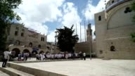 Members of the Jewish youth group Bnei Akiva dance in the Jewish quarter of the old city
